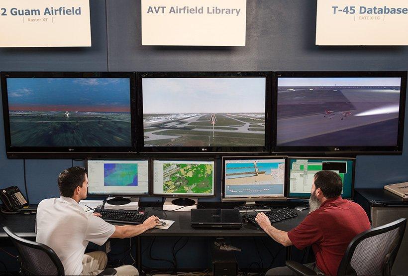AVT Database seven monitor two engineer photo